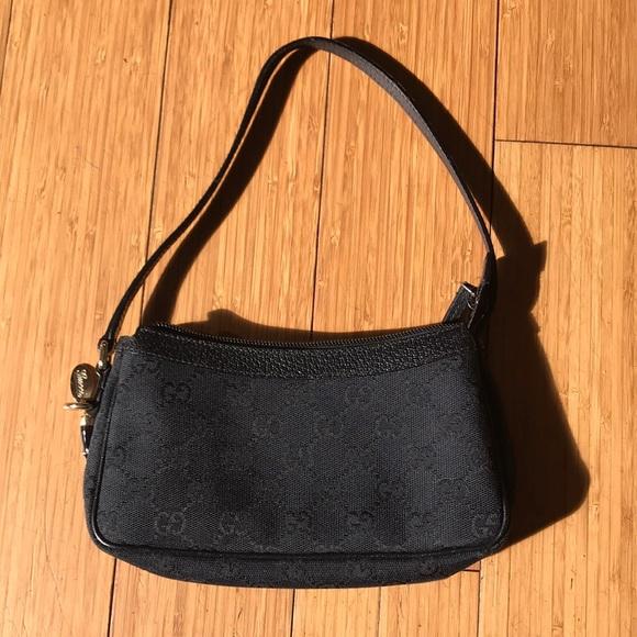 dcdad4ea069 Gucci Handbags - Gucci Black GG Monogram Small Canvas Bag
